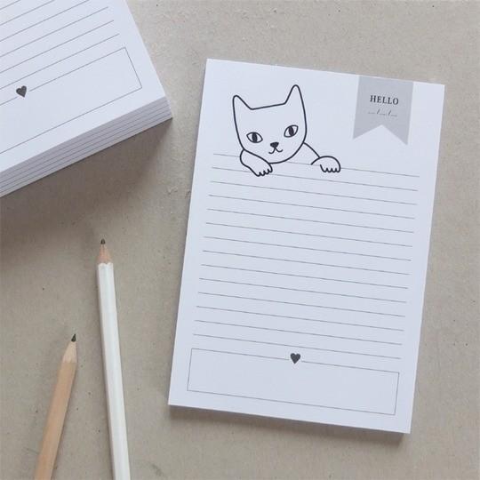 Un bloc note de Audrey Jeanne avec un chat qui vous dit : Hello !